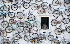 Pet Horstmann, head of the Fahrradhof bike shop in Altlandsberg, Germany, at his shop decorated with 210 old bikes.