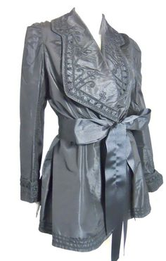 Victorian weighted black silk jacket with soutache collar, puff shoulders and pleated back bustle peplum.