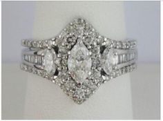 Beautiful three piece bridal set Photos do not do this setjustice! 2 CT total weight 14 KT white gold Further details are listed on the official appraisal certificate in the photos. Size 9 (resizable) Baguette/round/Marquise Purchased through Zales with a full lifetime jewelry commitment warranty. The ring has 2 broken prongs as highlighted in the photos...it is difficult to even notice in person, let alone photographs. This is fully covered through the insurance plan, I just do not…