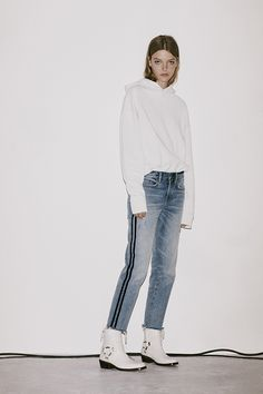 The Boys Stripe Jeans. A new edit to our boyfriend jeans are made with more relaxed, casual times in mind. Featuring a sporty inspired stripe running down each side of the leg. Pair with a simple tee and leather boots for an effortless, thrown-together look.