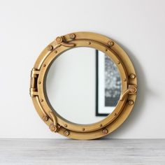 oh my gosh...my grandparents had a mirror like this and i would open the latch and leave secret messages on the wall. i think i was the only one who knew about it lol