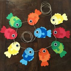 Best 11 This is the perfect addition to any Fish themed party! This listing is for a banner featuring Fish. Each Garland strand comes with 10 fish. This can be hanged vertically or horizontally! The main colors are red, orange, yellow blue and green. Under The Sea Decorations, Hawaiian Party Decorations, Birthday Decorations, Fish Banner, Decoration Creche, Fish Crafts, Dinosaur Crafts, Ocean Crafts, Summer Crafts For Kids