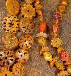 Carved 'Amber' beads of Mauritania | Ethnic Jewels Magazine
