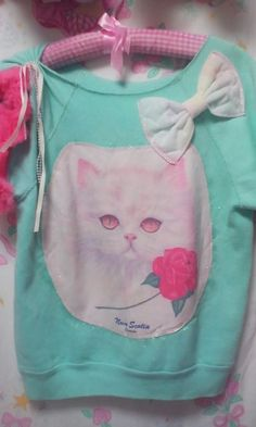 Kitty tshirt - Me and my sisters all had them! Added touch though, ours had rhinestones in their eyes !!