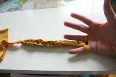 Finger knitting (I-cord with your fingers). Make bracelets, headbands, necklaces, belts. Cute.