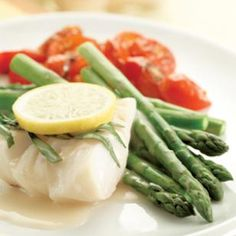 Poached Cod & Asparagus  In this recipe, we poach the cod right on top of the asparagus. The result is perfectly cooked cod and tender-crisp asparagus.  @eatingwell #asparagus