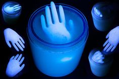 Use plastic gloves to make floating ice hands for your punch bowl. Add tonic water to make them glow under a black light.