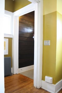 Bright gold walls and dark brown shiplap   Behr S-H-380 Burnished Bronze on the bottom, Behr 370D-7 Venetian Gold on top