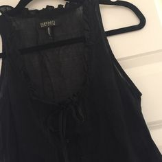 Black button up tank Sheer black button up tank. Great top and super cute!!! Wear with a tank under because it's so sheer!!! Great detailing. Pet and smoke free. No trades!! Buffalo Tops Button Down Shirts