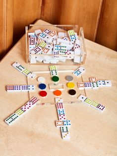 New set of dominoes by Luxe Dominoes. This Mexican Train Game set is meant to be displayed and played. The colorful set looks beautiful on your coffee table. --NOTES-- We love this set! We received our own game from Luxe as a wedding present <3