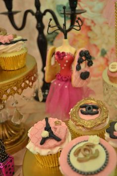 Fondant topped cupcakes at a Chanel engagement party! See more party planning ideas at CatchMyParty.com!
