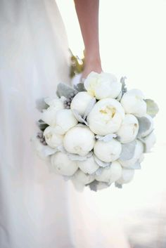 A gorgeous all-white peonies bouquet is the perfect complement to a flowing, tulle gown.