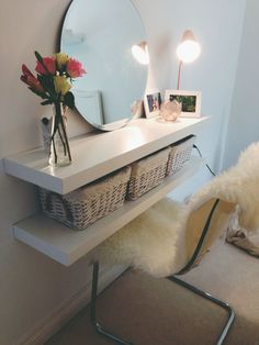 Couldn't afford a dressing table! Cheap DIY alternative  Ikea - 2 shelves, vase, photo frames, mirror, chair, candle holder (I used it to store my make up brushes)  Zara home - wicker storage baskets, candle holder Homebase - copper desk lamp