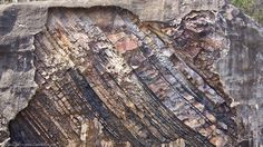 The mountains in Hot Springs National Park (Hot Springs, North, West, Sugarloaf, Music and Indian) are part of the Zig Zags which are the end of the Ouachitas. They were formed when the earth rolled a million give or take years ago and we have the cool diagonal layers you see in the image below.  When you hike you will see a spectacular array of rocks including Crystal, Sandstone, Tufa, Novaculite etc… and the occassional Diamond too!