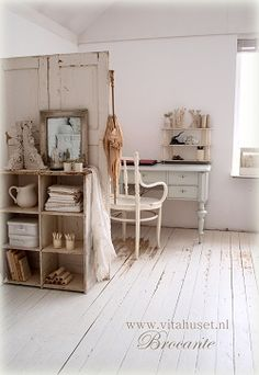 love the use of the old door as a small office divide.