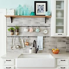 Pair a farmhouse sink with an oil-rubbed bronze faucet that features a modern pull-down spout. For more farmhouse flavor, replace upper cabinets with a shelf made from a 1 x 8 oak board and painted shelf brackets. Add function with hanging rods and S-hooks.