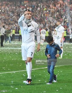 Cristiano Ronaldo and his son Cristiano Ronaldo jr celebrate the UEFA Champions League after winning the final match against Club Atletico de Madrid on May 29, 2016 in Madrid, Spain.
