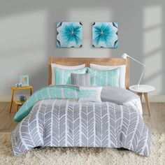 Create a colorblocked look in your bedroom with the Kennedy Collection. This geometric chevron design uses light grey, taupey grey and aqua for a unique update to this pattern. Two decorative pillows features teal as well to pull this whole look together.