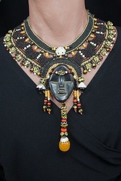 Necklace | Barbara Natoli Witt. Antique glass African trade beads and wood mask from the Dan people of Ivory Coast, beads of amber,  shell - old ivory beads, Italian red coral,  black coral.