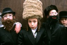 """The largest ultra-orthodox Hasidic Jewish Community in Europe lives in Stamford Hill, north London. For three years I attended their annual Purim festival, a holiday celebrating the miracle of Jewish survival. In the Old Testament, Esther is considered a heroine of the Jewish people, and according to the Talmud, the name Esther is derived from the Hebrew word nistar, meaning hidden. So during the carnival atmosphere, children in particular """"hide"""" behind elaborate masks."""