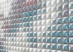 Aluminium panels blossom like flowers on warehouse by Brisac Gonzalez