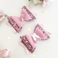 Pink Ballet Bows. Choice of either a ballerina or ballet slippers. Material: Made from 100% wool felt, chunky glitter fabric and metallic leatherette. Finished with a beautiful gem and diamanté ballet Slipper or ballerina embellishment. Size: The bows measure approximately 8cm and