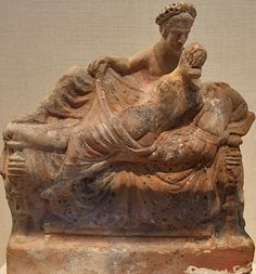 Courtesan reclines on a couch with a garlanded male who lifts her robe and is about to kiss her. Painted terracotta mold figurine from Greek Asia Minor, Myrina, late 2-1 century BCE. New York, Metropolitan Museum of Art.