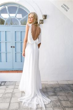 Sexy yet elegant, this white sleeveless bridal dress is perfect for boho weddings. Tank bodice features spaghetti straps, v neckline and allover lace appliques, A-line skirt with soft chiffon flows to floor, open v back.