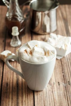 Make your own Pumpkin Spice Latte at home with this incredible recipe featuring a syrup that tastes just like Starbucks! Enjoy with homemade marshmallows!