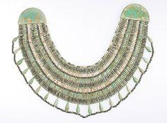 Broad collar Period: Middle Kingdom Dynasty: Dynasty 13 to 1700 B.C. Date: ca. 1802–1700 B.C. Geography: Egypt, Memphite Region, Lisht North, Tomb 954, Burial 954E, MMA 1921–1922 Medium: Black, white and blue-green faience