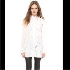 """*HP* Preowned Alexander Wang Top Preowned Alexander Wang top with distressed holes. Approx. 32""""L front and 31""""L back. Band collar; dropped long sleeves. Split back keyhole with long tie. Solid front placket. Long easy fit with shirttail hem. Viscose. Imported. Alexander Wang Tops"""