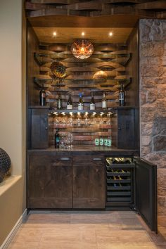 Wine Cellar Experts latest project - Approximately 100 bottles total. Note the wine staves used here! #winecellarexperts #winecellarshowcase #winebarrels