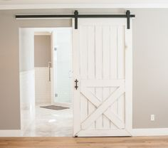 Barn door leading from master bedroom to bathroom by Rafterhouse in Phoenix, AZ 85018