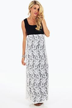 A colorblock maxi maternity dress with lace on the bottom.