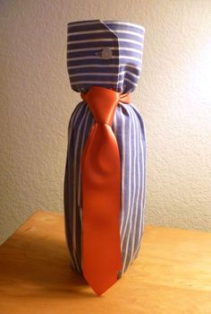 Wine bottle wrapped in shirt sleeve and tie.