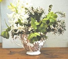 Scented teacup flower arrangement. Hyacinth, hellebore, heather.