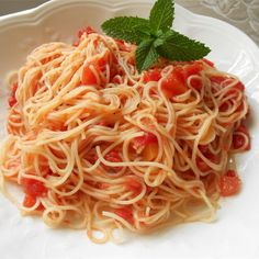 Tomato and Garlic Pasta | Bright red tomatoes are peeled and chopped and cooked very briefly with tomato paste and sauteed garlic.
