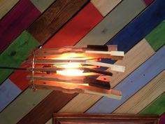 Old piano keys wired onto a simple craft ring. Suspend on a clamp light fixture (without the bell shade) and add a vintage bulb!