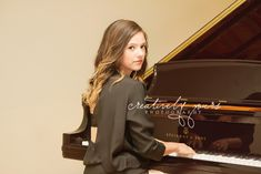 Senior pictures with steinway piano.  Spokane Senior pictures by Creatively Yours Photography.  #piano #seniorpictures #spokane