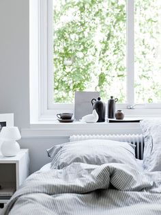 Position the bed in front of the window to get that light, bright Scandi look