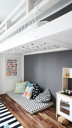 I like the idea of having a mattress with cushions in a reading corner. Would also double up for a bed for sleepovers.