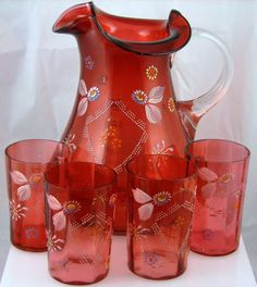 Vintage Cranberry Stained Victorian Water Set with floral decoration. Made late 1800's to Early 1900's.