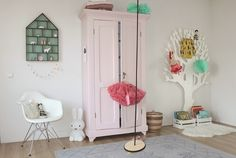 A cool girl's bedroom in green and dusty pink