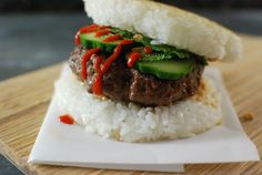 This burger uses two rice patties as the buns. For toppings, cucumber, mint, peanut, and sriracha.