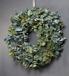 Mixed Eucalyptus Wreath - This beautiful wreath, made of eucalyptus, is the perfect modest door decoration. The wreath includes baby blue, silver dollar and flowering eucalyptus. wildatheart.com
