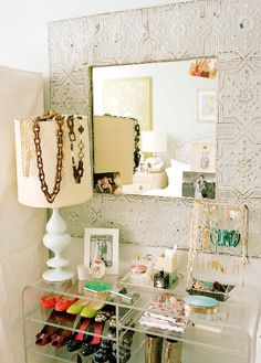 This is a little too organized for me but I like the idea of the shoe shelf + jewelry together.