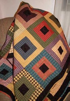 Stones pattern - love the colors of the homespun fabric in this quilt; black fabrics were used for the the centers.Stepping Stones pattern - love the colors of the homespun fabric in this quilt; black fabrics were used for the the centers. Flannel Quilts, Plaid Quilt, Quilt Baby, Strip Quilts, Easy Quilts, Jellyroll Quilts, Scrappy Quilts, Quilt Block Patterns, Quilt Blocks