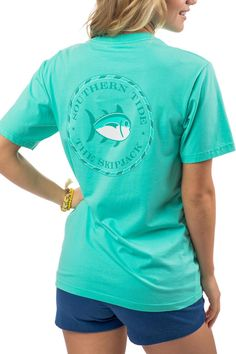 A fresh take on a classic design our Skipjack Seal T-shirt features a tonal circular Skipjack emblem on the back with an intertwined ST graphic on the front pocket. 100% Cotton Prewashed for comfort and softness Printed label for comfort Same as men's fit  Skipjack Seal T-Shirt by Southern Tide. Clothing - Tops - Tees & Tanks Sandestin Golf and Beach Resort Florida