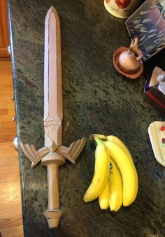 I made the Master Sword out of cardboard! Bananas for scale. Cardboard Sword, Cardboard Costume, Cardboard Mask, Cardboard Crafts, Zelda Master Sword, Zelda Sword, Sword Craft, Cosplay Sword, Armas Ninja