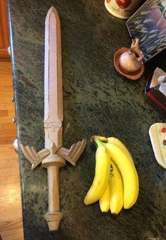 I made the Master Sword out of cardboard! Bananas for scale. Cardboard Sword, Cardboard Costume, Cardboard Mask, Cardboard Crafts, Diy Maleficent Horns, Sword Craft, Zelda Sword, Cosplay Sword, Dremel Wood Carving